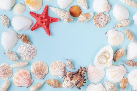 Rings on a shell, a decor for a wedding table on the shells frame background
