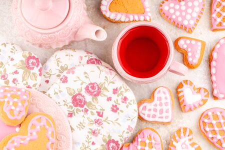 Pink Teapot with Mug, Flower Gloves and Plate of Handmade Heart Shaped Cookies