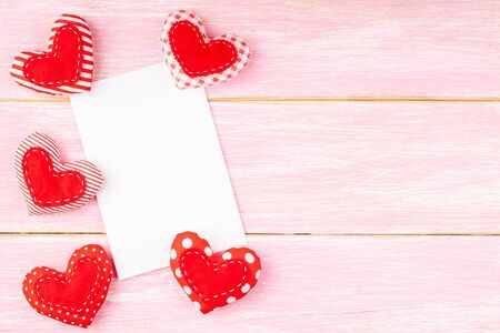 Valentines Day Background with Blank White Card and Handmade Textile Hearts