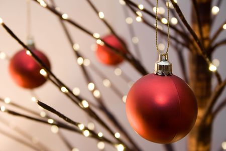 Red christmas ornaments hanging from christmas tree Stock Photo - 928407
