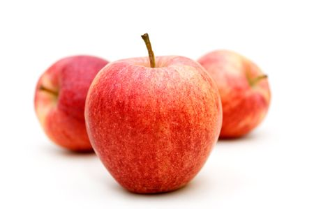 Four red apples on white isolated background