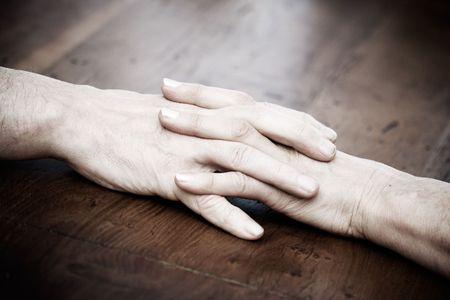 in loving memory: Senior man and woman holding hands
