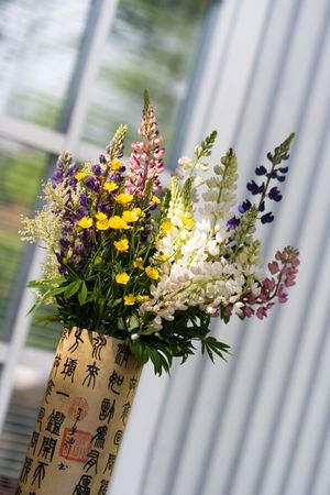 Bunch of natural summer flowers in vase