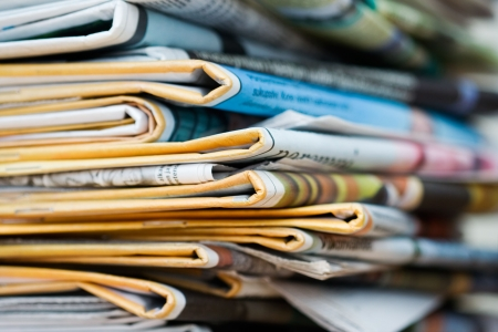 pile reuse: Big pile of newspapers, focus in front