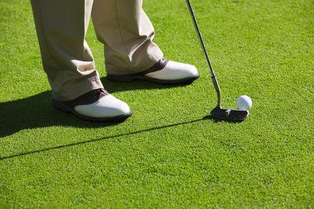 Close-up of man playing golf Stock Photo