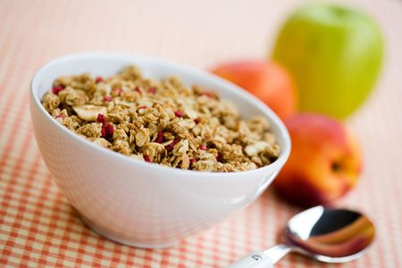 Breakfast cereal with dried fruits and fresh peaches Stock Photo