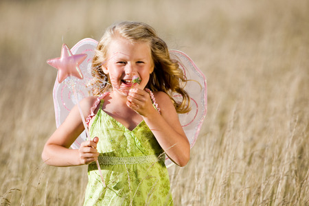 Little girl with butterfly wings and magic wand Stock Photo