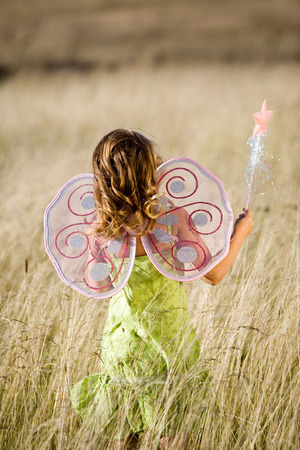 fairy wings: Little gilr with butterfly wings and magic wand