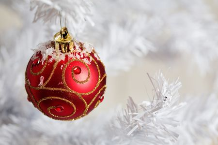 Red christmas decorations on white christmas tree Stock Photo