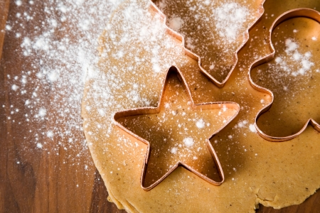 christmas gingerbread: Baking christmas cookies with star and tree motif Stock Photo