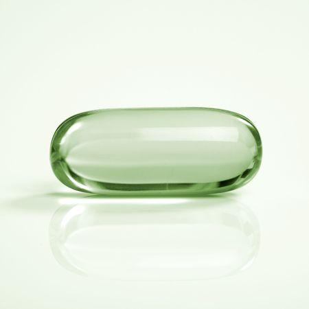 Vert transparent m�decine capsule de r�flexion sur le tableau