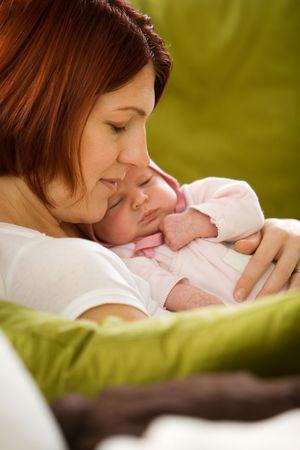 Mother holding newborn  girl