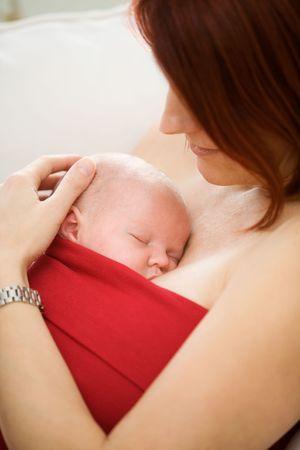 Mother holding sleeping baby girl Stock Photo