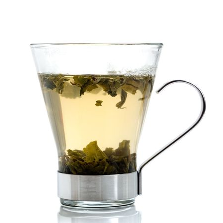 Green tea in glass isolated on white photo