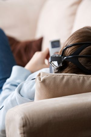 Teenager listening music on the couch Stock Photo - 2374747