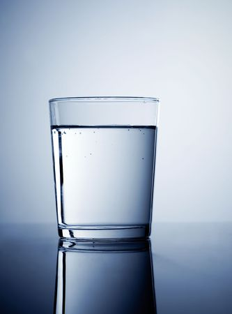 Glass of fresh water, coloured with blue