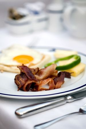 Delicious hotel breakfast with bacon and eggs photo