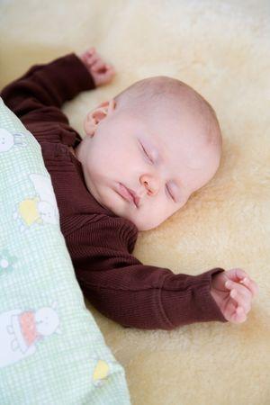 Little baby sleeping under green blanket photo