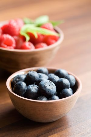 Fresh raspberries and blueberries in brown bowl Stock Photo - 3146821