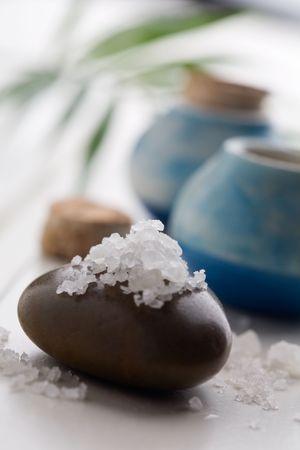 cleaness: White bath salt on brown massage stone