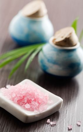cleaness: Pink bath salt and little jars on table Stock Photo