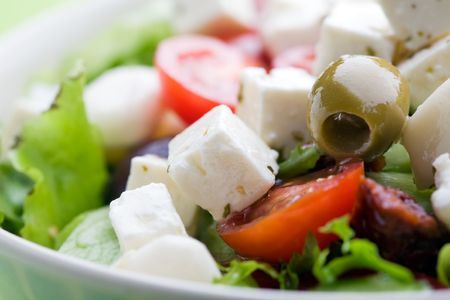 Feta salad with tomatoes and green olives photo