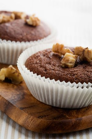Chocolate muffins with crushed nuts photo
