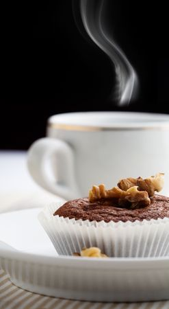Cup of coffee wiht chocolate muffin photo