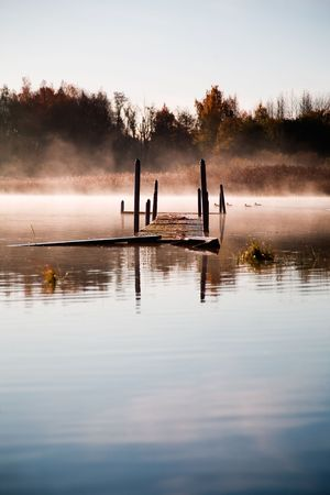 Beautiful morning mist by the lake photo