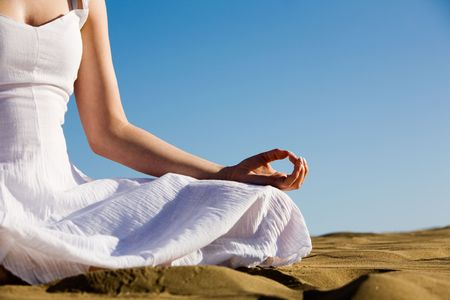 meditating woman: Young woman relaxing on the beach Stock Photo