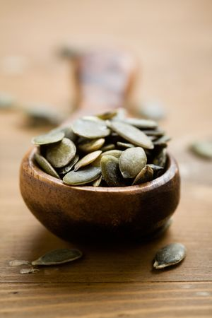 Pumpkin seeds on wooden spoon photo