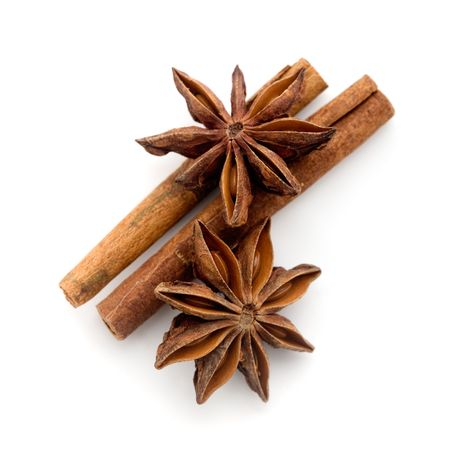 Star anis and cinnamon stick on white
