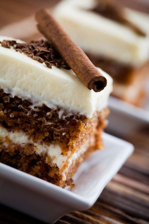 spice cake: Delicious pieces of carrot cake with cinnamon stick Stock Photo