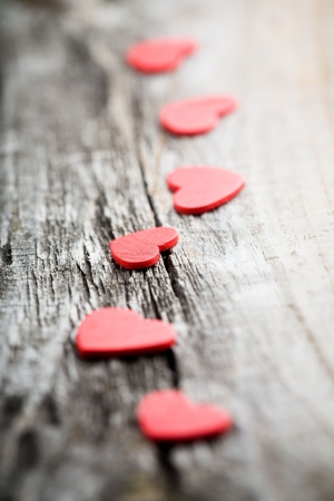 Little red hearts on old wooden background Stock Photo - 6056809