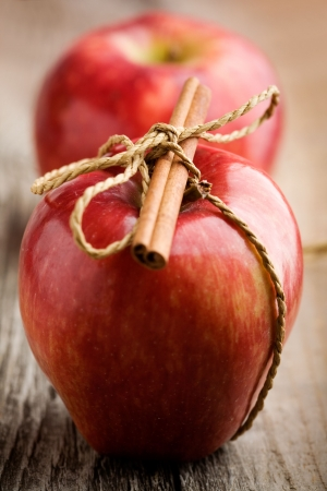 apple and cinnamon: Red apples with cinnamon stick, shallow focus