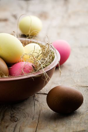 Easter eggs painted in yellow, pink and brown photo