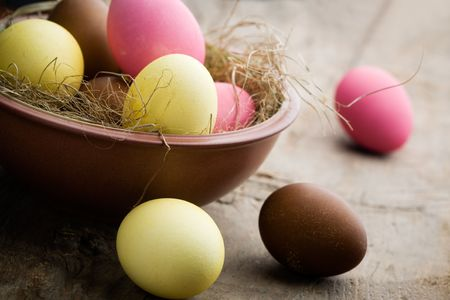 Easter eggs painted in yellow, pink and brown