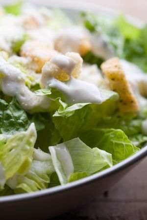 croutons: Ceasar salad with lots of dressing and parmesan  Stock Photo