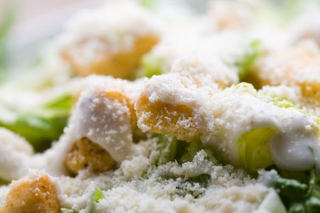 Ceasar salad with lots of dressing and parmesan  photo