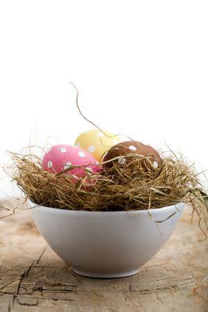 Painted easter egg in little bird nest photo