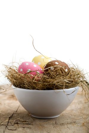 Painted easter egg in little bird nest photo