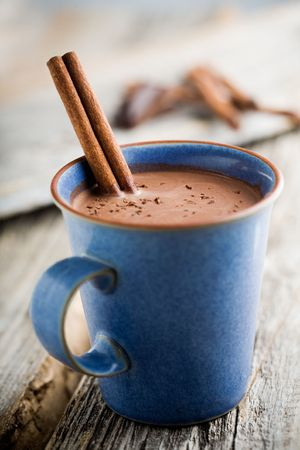 hot chocolate drink: Hot chocolate with cinnamon stick as spoon Stock Photo