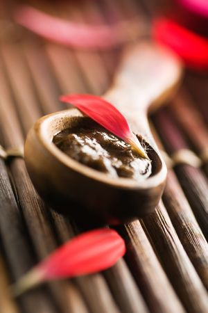 Brown sugar body polish on wooden spoon