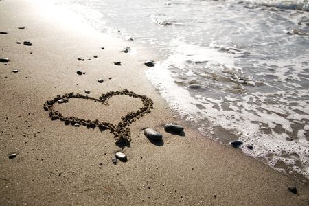 Heart drawn to the beach by the sea photo
