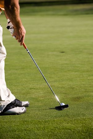 Golfer getting ready to hit the ball Stock Photo