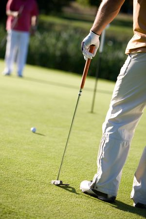 golfers playing golf on beautiful sunny day Stock Photo - 7622445