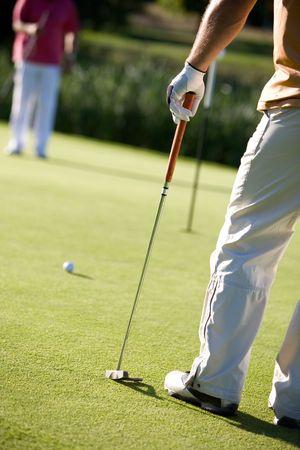golfers playing golf on beautiful sunny day photo