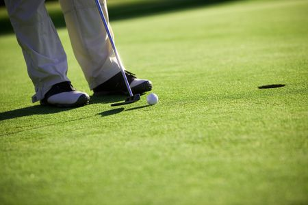 putting: Golfer putting, selective focus on golf ball Stock Photo