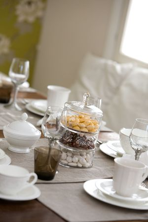 Elegant table setting for afternoon coffee or tea photo