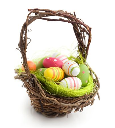 easter decorations: Colorful painted easter eggs in brown basket